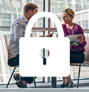 White padlock icon overlaying a photo of a man and woman sitting at a table in an office