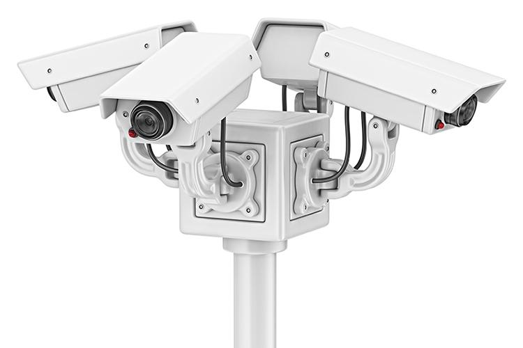 Three security cameras on a pole