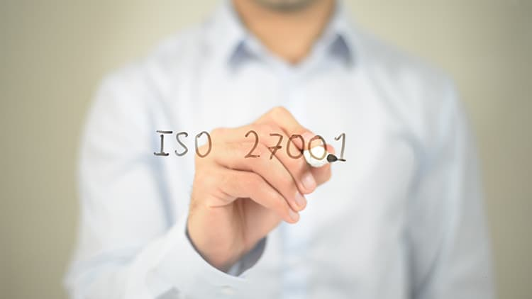 Man writing ISO 27001