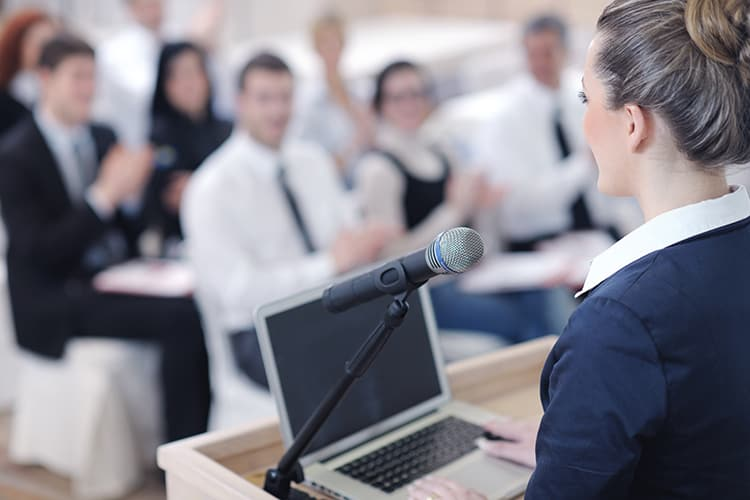 Woman presenting with laptop
