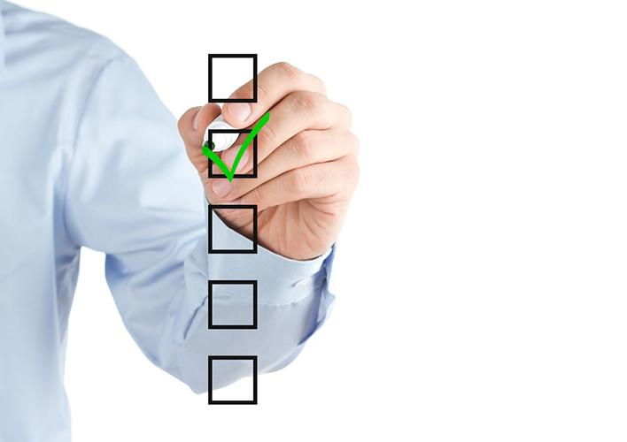 Man drawing green tick on checkbox