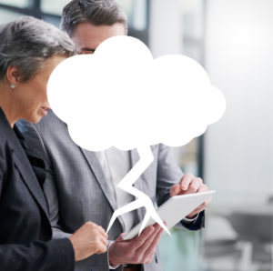 Business man and woman looking at tablet with thunder cloud overlay