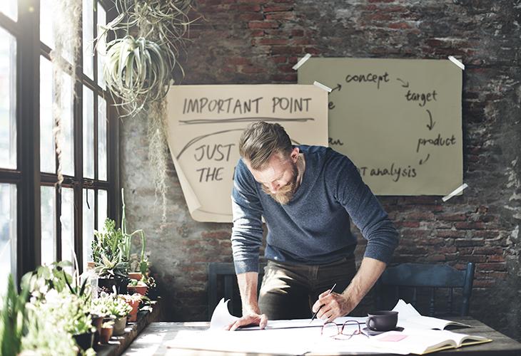 Man working on table in studio