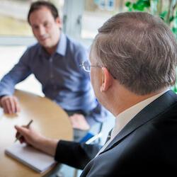 Two men sitting at desk