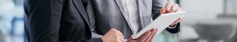 Business men looking a paper report