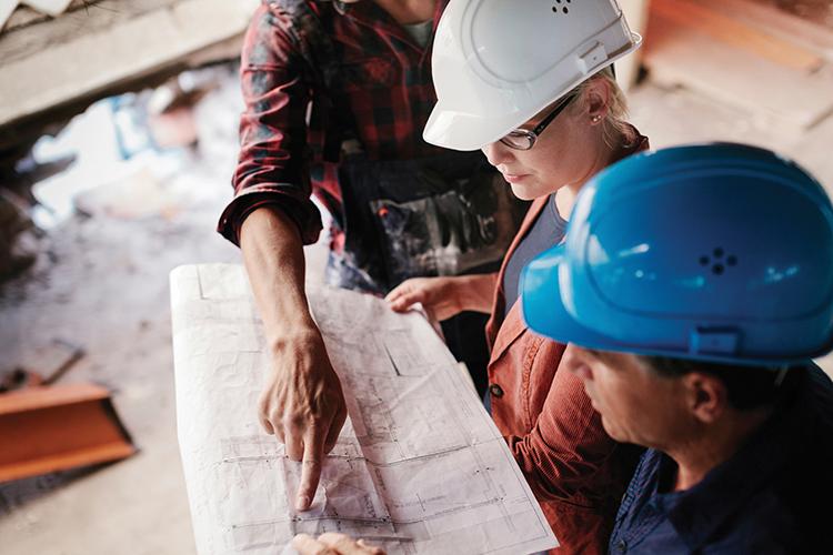 Builders looking over designs
