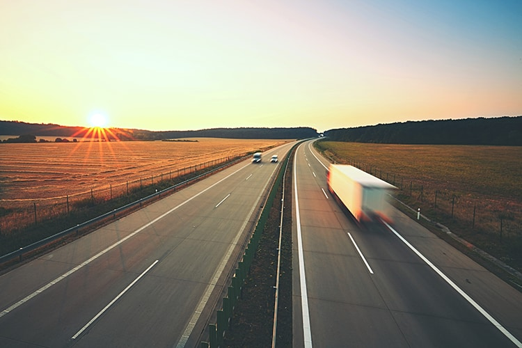 Lorry travelling along empty road