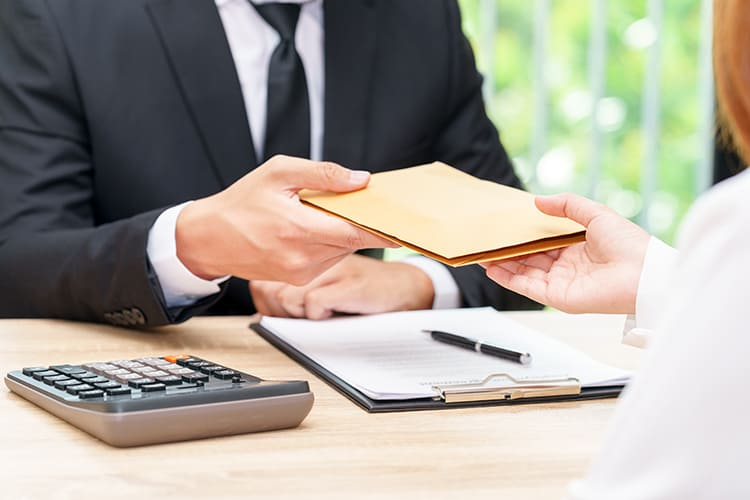Businessman accepting money in envelope offered by a woman